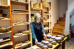 Istanbul - Turkey - 05 February 2015 -- Young entrepreneurs. -- Zeynep Toptas, 22, organizes the goods at the Reklam Hizmetleri ( a wood and ceramic store)  -- PHOTO: Agata SKOWRONEK / EUP-IMAGES