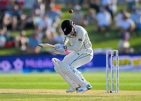 NZ's Henry Nicholls is hit in the helmet during day two of the international cricket 1st test match between NZ Black Caps and England at Bay Oval in Mount Maunganui, New Zealand on Friday, 22 November 2019. Photo: Dave Lintott / lintottphoto.co.nz