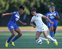 Western New York Flash midfielder Carli Lloyd (10) dribbles as Boston Breakers forward Lianne Sanderson (10) closes. In a National Women's Soccer League (NWSL) match, Boston Breakers (blue) tied Western New York Flash (white), 2-2, at Dilboy Stadium on August 3, 2013.