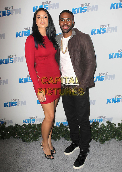 Jordin Sparks, Jason Derulo.KIIS FM 2012 Jingle Ball - Night 2 held at Nokia Theatre L.A. Live, Los Angeles, California, USA..3rd December 2012 .full length white top brown jacket grey gray fur gold necklace beard facial hair black jeans denim red dress couple .CAP/ADM/KB.©Kevan Brooks/AdMedia/Capital Pictures.