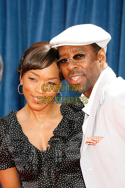 "ANGELA BASSETT & husband COURTNEY B. VANCE.Attending the ""Meet The Robinsons"" Los Angeles Premiere held at the El Capitan Theatre, Hollywood, California, USA, 25 March 2007..portrait headshot cap hat glasses married wife.CAP/ADM/RE.©Russ Elliot/AdMedia/Capital Pictures."