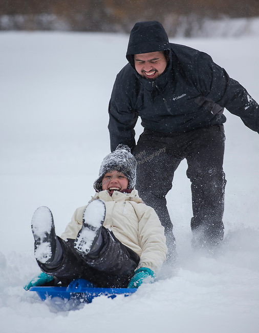Melissa Martinze and Ruben Garcia from the Bay Area play in the fresh snow near the summit of the Mt. Rose Highway on Monday, February 26, 2018.
