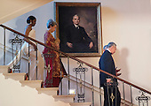 United States President Barack Obama and First Lady Michelle Obama descend the Grand Staircase prior to posing for an official photo with Singapore Prime Minister Lee Hsien Loong and Madam Ho Ching on the Grand Staircase at the White House in Washington, DC on Tuesday, August 2, 2016. <br /> Credit: Leigh Vogel / Pool via CNP