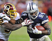 Landover, MD - November 16, 2008 -- Dallas Cowboys running back Marion Barber (24) pushes off Washington Redskins linebacker London Fletcher (59) as he carries the ball late in the fourth quarter against the Washington Redskins at FedEx Field in Landover, Maryland on Sunday, November 16, 2008.  Barber finished the game with 114 yards on 24 carries.  Dallas won the game 14 - 10..Credit: Ron Sachs / CNP