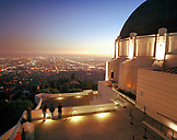 USA, California, Los Angeles, tourists take in the view of Los Angeles at night from the Griffith Park Observatory