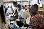 ACCRA, GHANA - JUNE 12: Local residents use computers at Busy Internet Cafe on June 12, 2008 in central Accra, Ghana. It's the busiest Internet café in Accra. (Photo by Per-Anders Pettersson)...