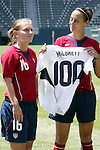 24 July 2005: U.S. captain Kate Markgraf (right) holds the commemorative jersey presented to Tiffeny Milbrett (left) in pregame to commemorate her 100th international goal. The United States defeated Iceland 3-0 at the Home Depot Center in Carson, California in a Women's International Friendly soccer match.