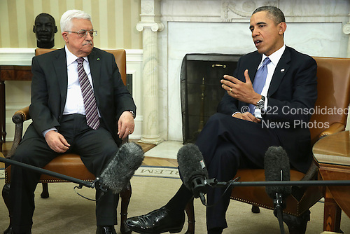 United States President Barack Obama (R) meets with Palestinian President Mahmoud Abbas (L) in the Oval Office of the White House March 17, 2014 in Washington, DC. President Obama met with President Abbas to discuss the progress in the Israeli-Palestinian negotiations and the establishment of a Palestinian state. <br /> Credit: Alex Wong / Pool via CNP