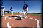 Wildcats prep the field before a game at Western Nevada College in Carson City, Nev., on Thursday, March 5, 2015. <br /> Photo by Cathleen Allison/Nevada Photo Source
