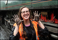 BNPS.co.uk (01202)558833<br /> Pic: PhilYeomans/BNPS<br /> <br /> Hands on experience - Beth Attfield-Haines(29) is still in training on the Swanage Railway.<br /> <br /> Growth Industry - Britain's enduring love affair with steam trains has led to a critical shortage of drivers, 56 years after the infamous Beeching Axe was supposed to have fallen.<br /> <br /> More steam train's are running today than at anytime since Dr Beechings drastic cut in 1963 - with over 150 steam heritage railways and museums attracting 13 million visitors a year.<br /> <br /> One of the most popular heritage railways in the country has put out an SOS for steam drivers - as so many of its stalwarts are retiring.<br /> <br /> Swanage Railway in Dorset has 42 steam drivers on their books, but the majority are in their 60s or older and likely to step down in the coming years.<br /> <br /> They need to train up to 40 drivers over the next five years to replace them and meet their expanding service, which attracts over 200,000 visitors each year.<br /> <br /> To fill the void, a group of enthuisastic young volunteers are being taught the skill, a process which can take up to a decade.<br /> <br /> The Heritage Railway Association, which oversees them, says some of their railways have a 'more pressing need for new blood'.