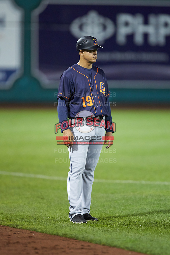 Bowling Green Hot Rods manager Reinaldo Ruiz (19) coaches third base during the game against the Fort Wayne TinCaps at Parkview Field on August 20, 2019 in Fort Wayne, Indiana. The Hot Rods defeated the TinCaps 6-5. (Brian Westerholt/Four Seam Images)