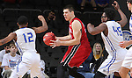 SIOUX FALLS, SD - MARCH 5:  Tyler Flack #23 of South Dakota drives against Michael Calder #12 of Fort Wayne in the 2016 Summit League Tournament. (Photo by Dick Carlson/Inertia)