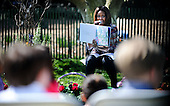 United States first lady Michelle Obama reads the story My Garden to children during the annual White House Easter Egg Roll on the South Lawn of the White House April 21, 2014 in Washington, DC. President Barack Obama and first lady Michelle Obama hosted thousands of people during the annual celebration of Easter. <br /> Credit: Olivier Douliery / Pool via CNP