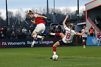 Vivianne Miedema of Arsenal tangles with Sophie Bradley-Auckland of Liverpool during Arsenal Women vs Liverpool Women, Barclays FA Women's Super League Football at Meadow Park on 24th November 2019