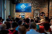 Pictured: Gareth Bale speaks to Ian Gwyn Hughes from the FAW at his Elevens Bar in Cardiff, Wales, UK. Thursday 12 July 2018<br /> Re: Last night (Thurday 12 July) Elevens Bar &amp; Grill and the Football Association of Wales jointly hosted a Q&amp;A evening with Gareth Bale. At the event, Gareth unveiled a new piece of memorabilia for Elevens &ndash; his match worn boots from this year&rsquo;s Champions League Final with which he scored that incredible overhead kick.<br /> The event, hosted at Elevens Bar &amp; Grill was open to members of the public with doors opening at 6pm on Thursday evening. People started queueing from 3pm, with a cross-section of fans of all ages in Wales shirts and bucket hats. <br /> The Q&amp;A, conducted by Ian Gwyn Hughes from the FAW, discussed all aspects of his career so far, from growing up in Cardiff to winning 4 Champions League medals with Real Madrid. On growing up in Whitchurch, Gareth said: &ldquo;My family were a huge influence on me growing up. My parents were so supportive, taking me here there and everywhere so I could play football. Growing up I can hardly remember not being with a football &ndash; I even took one to bed!&rdquo;<br /> There were a lot of youngsters in the audience, eager to hear from their hero. Gareth&rsquo;s advice to them? &ldquo;Work hard for what you want and who knows where that could take you.&rdquo;<br /> As a left-footer, Ryan Giggs,  Wales&rsquo; national team manager was someone he looked up to growing up. Gareth mentioned it was great to beat Ian Rush&rsquo;s goal scoring record for Wales with his childhood idol as manager. &ldquo;I knew I&rsquo;d levelled his record at half time, I needed one more to break it. The manager wanted to take me off but I said give me another 15 minutes to see if I can do it. Luckily on 61 minutes our goalkeeping coach took too long to do the substitution on the paper, so it gave me an extra minute. It worked out perfectly.&rdquo;
