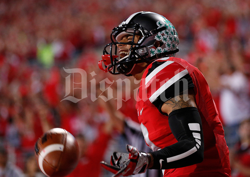Ohio State Buckeyes wide receiver Devin Smith (9) reacts after catching a touchdown pass in the first quarter of the NCAA football game at Ohio Stadium in Columbus, Saturday evening, September 28, 2013. As of halftime the Ohio State Buckeyes led the Wisconsin Badgers 24 - 14. (Columbus Dispatch  / Eamon Queeney)