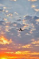 Jet landing at sunset in Portland, Oregon