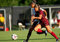 WINSTON-SALEM, NORTH CAROLINA - August 30, 2013:<br /> Rachel Melhado (24) of Louisville University tries to get away from Jazmine Reeves (5) of Virginia Tech during a match at the Wake Forest Invitational tournament at Wake Forest University on August 30. The game ended in a 1-1 tie.