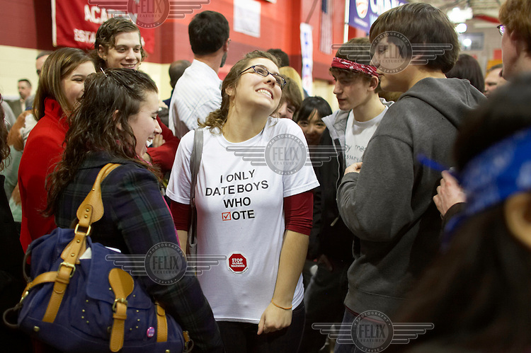 Caryn Smith, 17, a Senior at Pinkerton Academy, wears a T-shirt saying 'I Only Date Boys Who Vote' before a rally for Barack Obama, Democrat candidate for President, during the New Hampshire primary campaign.