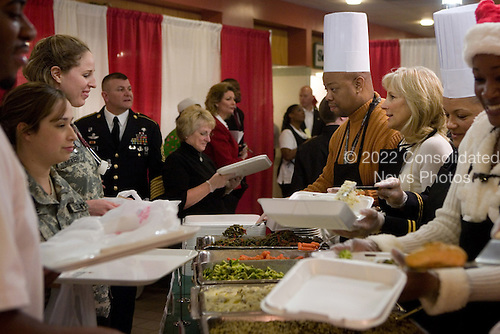 Washington, DC - December 25, 2009 -- Dr. Jill Biden serves lunch to patients and staff in the dining facility at Walter Reed Army Medical Center on Christmas Day, Friday, December 25, 2009. The Vice President and Dr. Biden served Christmas lunch and met with families and wounded soldiers during their visit to Walter Reed. .Mandatory Credit: David Lienemann - White House via CNP