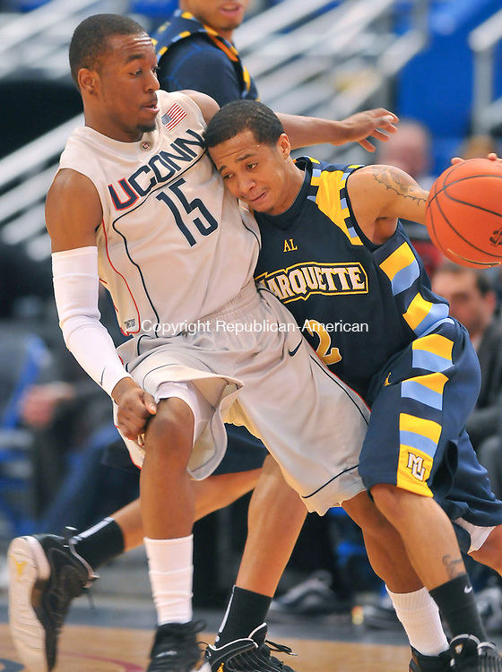 HARTFORD, CT- 30 JANUARY 2010-013010JS02--UConn's Kemba Walker (15) plays tight defense on Marquette's Maurice Acker (2) during their game Saturday at the XL Center in Hartford. <br /> Jim Shannon Republican-American