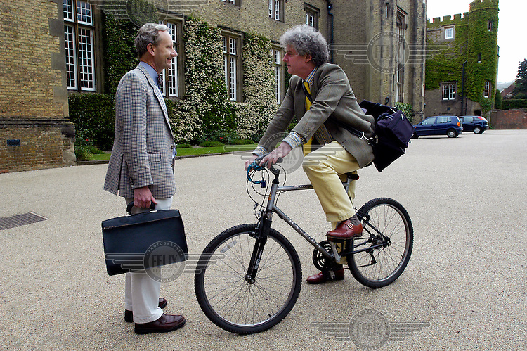 Masters (teachers) talking before lessons at Rugby School, one of the oldest public (private) schools in England.