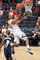 CHARLOTTESVILLE, VA- December 3: Mike Scott #23 of the Virginia Cavaliers shoots the ball in front of Longwood Lancer defenders during the game on December 27, 2011 at the John Paul Jones Arena in Charlottesville, Virginia. Virginia defeated Longwood 86-53. (Photo by Andrew Shurtleff/Getty Images) *** Local Caption *** Mike Scott