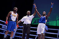 Fairfax, VA - July 1, 2015: Jay Gregory of the Metropolitan Police-London, England, raises his hands in victory after winning a boxing match against Darnell Hamilton (l) of the Kansas City Fire Department during the World Police and Fire Games at the George Mason University July 1, 2015.   (Photo by Don Baxter/Media Images International)