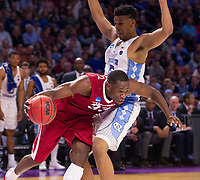 NWA Democrat-Gazette/J.T. WAMPLER Arkansas' Moses Kingsley tries to get around  North Carolina's Tony Bradley Sunday March 19, 2017 during the second round of the NCAA Tournament at the Bon Secours Wellness Arena in Greenville, South Carolina.