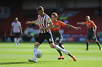 Sheffield United's Lee Evans battles with Swansea City's Bersant Celina during the Sky Bet Championship match between Sheffield United and Swansea City at Bramall Lane, Sheffield, England, UK. Saturday 04 August 2018