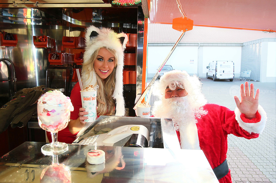 07/12/11 ***NO REPRODUCTION FEE***Model Tiffany Stanley pictured with Santa at Eddie Rockets Diner, Walkinstown this morning where she launched the Eddie Rocket's Christmas Pudding Shake, which goes on sale at City Dinners and Shake Shops nationwide today..The shake includes three scoops of 100% Irish Ice Cream and a chunk of Plum Pudding, hand dipped and topped with Whipped Cream and Cinnamon,.Every time  a Christmas Pudding Shakeis bought  in December, Eddie Rockets franchisees will donate EUR1 to Irish Osteoporosis Society which faces closure this year if they do not receive urgent funding..The Christmas Pudding Shake is joined on Eddie Rocket's festive menu by another seasonal treat, Christmas Cake Pops, which can be had for EUR3.50...***NO REPRODUCTION FEE***..Picture Colin Keegan, Collins, Dublin.