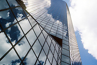 REFLECTIONS IN MIRRORED BUILDING<br /> Glass Building Is Highly Reflective<br /> Mirrored glass creates a virtual image of clouds in the sky.