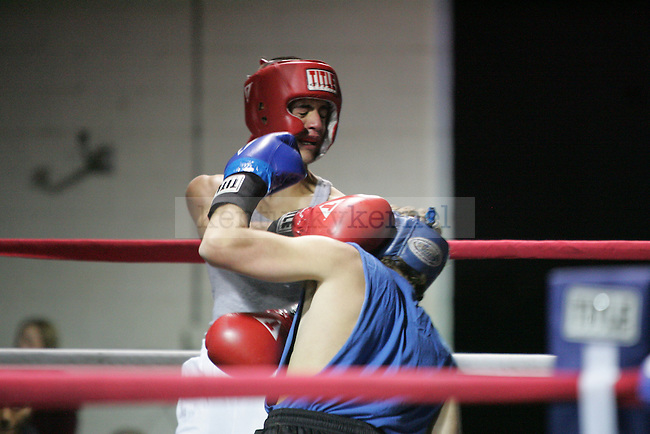 James McKnight (R) of Delta Tau Delta takes a punch from Alex Vukmer (L) of Phi Sig at The Main Event, where proceeds benefitted The Huntsman Cancer Institute and The Ronald McDonald House in Lexington, Ky. on 11/11/11. Photo by Quianna Lige | Staff