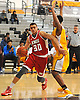 Omar El Sheikh #30 of The Knox School (St. James), left, tries to drive to the hoop during a non-league game against Our Saviour Lutheran (Bronx) in the inaugural Empire Invitational at Adelphi University on Saturday, Jan. 7, 2017. Lutheran defeated Knox by a score of 74-66.
