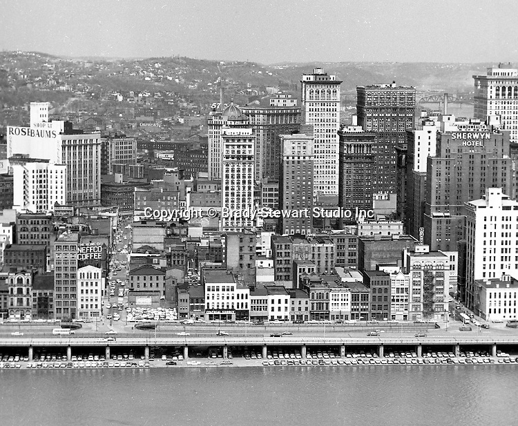 Pittsburgh PA:  View of the city's skyline - 1962.  View includes the Grant, William Penn Place, and Gulf Buildings, and the many businesses on Fort Pitt Boulevard.