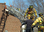 WATERBURY, CT-11 February 2014-0201114BF03- Waterbury Fire Department firefighters worked to contain an apartment fire at a condo complex on Waterville Street Tuesday morning. No injuries to residents or firefighters were reported.  Bob Falcetti Republican-American