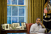 President Barack Obama talks with American service men and women during phone calls from the Oval Office on Thanksgiving Day, Nov. 26, 2009..Mandatory Credit: Pete Souza - White House via CNP