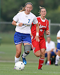 BROOKINGS, SD - AUGUST 16:  Diana Potterveld #7 from South Dakota State University pushes the ball past Andrea Angioli #6 from Winnipeg in the first half of their game Friday evening at Fischback Soccer Field in Brookings. (Photo by Dave Eggen/Inertia)