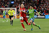 Toronto, ON, Canada - Saturday Dec. 10, 2016: Michael Bradley, Nicolas Lodeiro during the MLS Cup finals at BMO Field. The Seattle Sounders FC defeated Toronto FC on penalty kicks after playing a scoreless game.