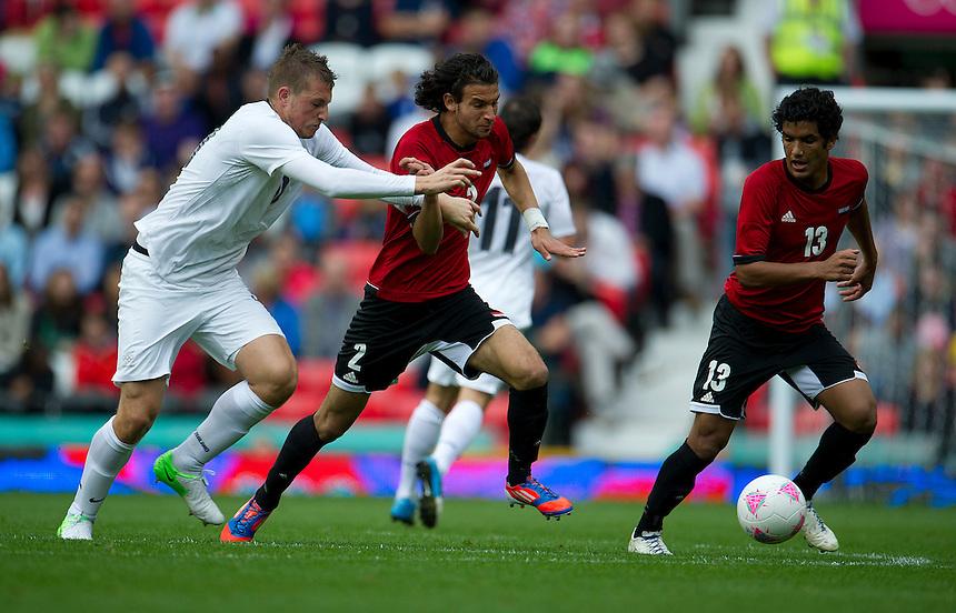 Egypt's Mahmoud ALAA ELDIN (2) and New Zealand's Chris WOOD ..2012 London Olympics - Football - Group C - Egypt v New Zealand - Sunday 29th July 2012 - Old Trafford - Manchester ..