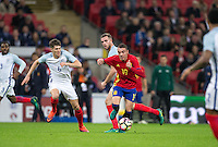 Iago Aspas of Spain moves away from John Stones (Man City) of England during the International Friendly match between England and Spain at Wembley Stadium, London, England on 15 November 2016. Photo by Andy Rowland.