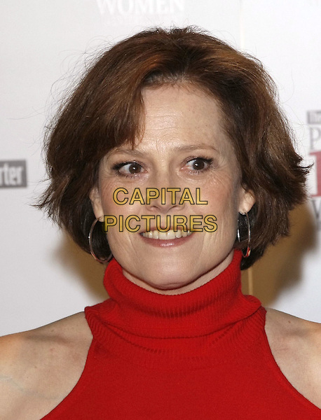 SIGOURNEY WEAVER .at The Hollywood Reporter's Annual Women in Entertainment Breakfast held at The Beverly Hills Hotel in Beverly Hills, California, USA, .December 5th 2008.                                                                     .portrait headshot orange polo neck .CAP/DVS.©Debbie VanStory/Capital Pictures