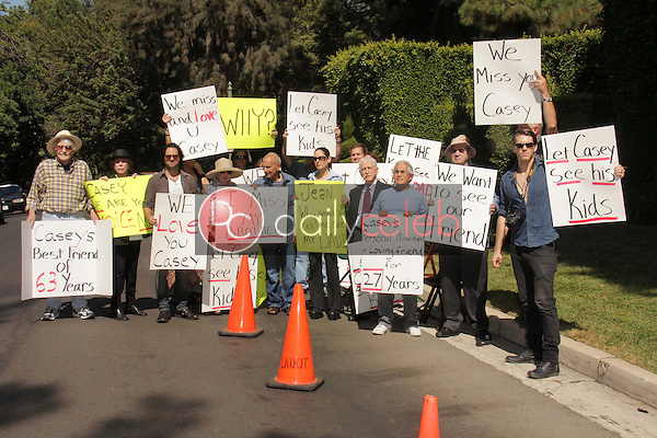 Charles Olsen. Eilene Olsen, Jason Thomas Gordon, Mouner Kasem, Kerri Kasem, Don Bustany, Gonz Venecia, Jesse Kove<br /> at a protest involving Casey Kasem's children, brother and friends who want to see him but have been denied any contact,  Private Location, Holmby Hills, CA 10-01-13<br /> David Edwards/Dailyceleb.com 818-249-4998