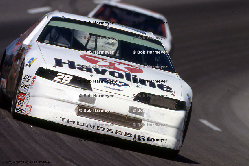 Davey Allison drives his Ford Thunderbird during the 1989 NASCAR Winston Cup race at Darlington Raceway near Darlington, North Carolina.