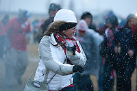 Battling snowflakes and high winds, USA fans march to enter Dick's Sporting Good Park in Commerce City, CO before the USA Men's National Team's World Cup Qualifier against Costa Rica on March 22, 2013.