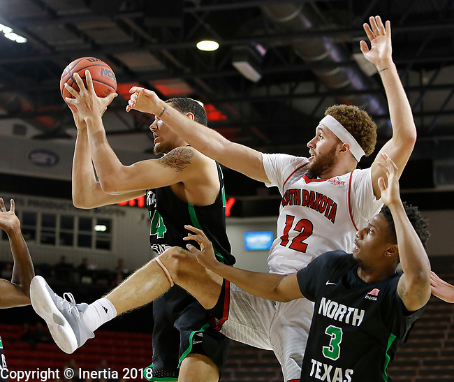 VERMILLION, SD: MARCH 14:  Trey  Burch-Manning #12 of South Dakota and Zachary Simmons #24 of North Texas battle for a rebound during the 2018 CBI Basketball Tournament at the Sanford Coyote Sports Center in Vermillion, S.D. Roosevelt Smart #3 of North Texas is at right. (Photo by DIck Carlson/Inertia)