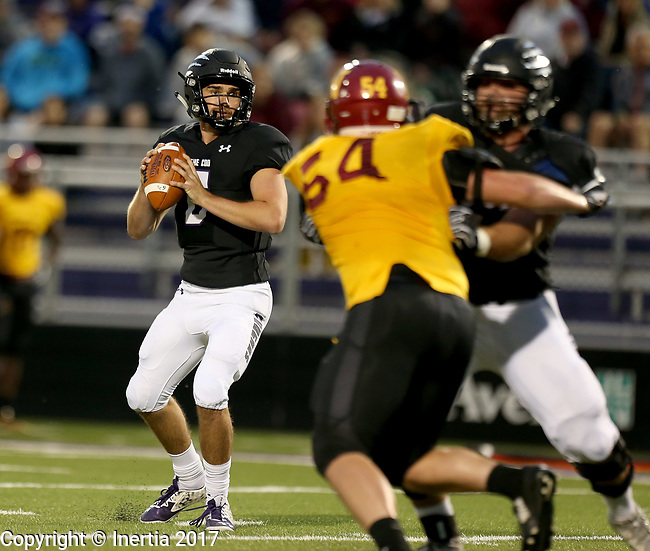 SIOUX FALLS, SD - SEPTEMBER 8: Ian Fieber #6 from the University of Sioux Falls looks for a receiver against Northern State in the first half of their game Saturday night at Bob Young Field in Sioux Falls. (Photo by Dave Eggen/Inertia)