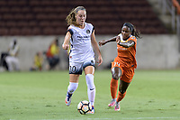 Houston, TX - Saturday July 08, 2017: Celeste Boureille dribbles the ball away from Nichelle Prince during a regular season National Women's Soccer League (NWSL) match between the Houston Dash and the Portland Thorns FC at BBVA Compass Stadium.