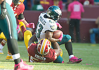 Philadelphia Eagles running back Darren Sproles (43) is tackled by Washington Redskins inside linebacker Will Compton (51) in fourth quarter action at FedEx Field in Landover, Maryland on Sunday, October 16, 2016.<br /> The Redskins won the game 27 - 20.<br /> Credit: Ron Sachs / CNP /MediaPunch