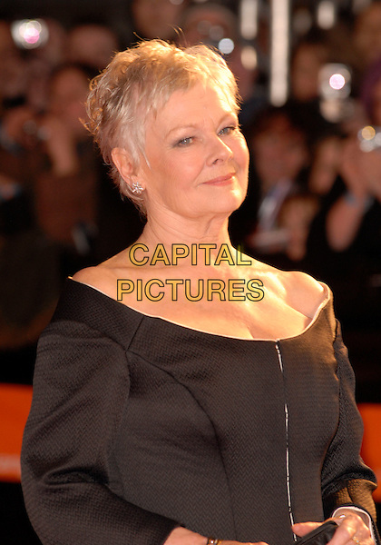 DAME JUDI DENCH.Red Carpet Arrivals at The Orange British Academy Film Awards (BAFTA's) held at the Royal Opera House, Covent Garden, London, England, February 11th 2007..half length off the shoulder black jacket.CAP/IL.©Ian Leonard/Capital Pictures